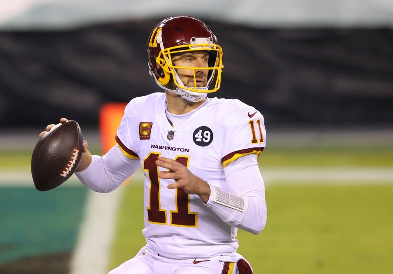 FILE – In this Jan. 3, 2021, file photo, Washington Football Team quarterback Alex Smith (11) prepares to throw against the Philadelphia Eagles during an NFL football game in Philadelphia. Retired Washington quarterback Smith has won the George Halas Award presented by the Pro Football Writers of America. (AP Photo/Rich Schultz, FIle)