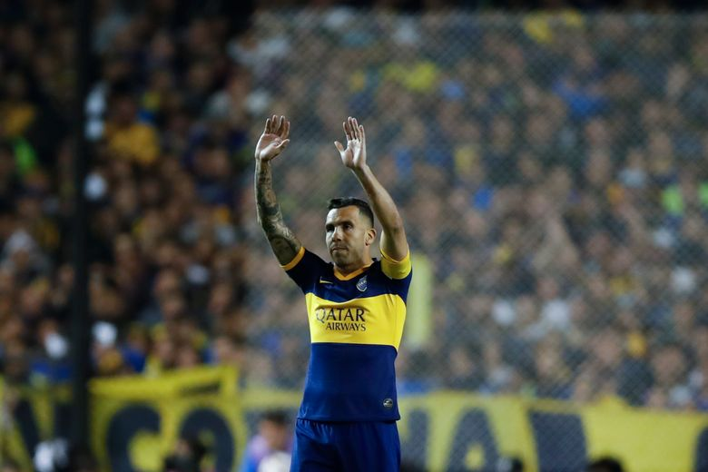 FILE – In this Oct. 22, 2019 file photo, Carlos Tevez of Boca Juniors, waves prior to the Copa Libertadores semifinal second leg soccer match against River Plate, at La Bombonera stadium in Buenos Aires, Argentina. Tevez in a press conference on Friday, June 4, 2021 announced his departure from the team.  (AP Photo/Natacha Pisarenko, File)