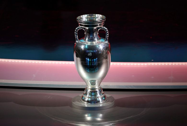 FILE – In this Sunday, Dec. 2, 2018 file photo the Henri Delaunay Trophy is displayed on the stage at the Convention Centre in Dublin, Ireland. France won the last major international soccer tournament — the World Cup in 2018 — by defending compactly, hitting teams on the break with clinical finishing, and being effective at set pieces. What will the winning approach be at the European Championship? (AP Photo/Peter Morrison, File)