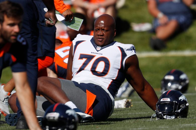FILE – In this July 19, 2019, file photo, Denver Broncos offensive tackle Ja'Wuan James (70) stretches during NFL football training camp in Englewood, Colo. James filed a $15 million grievance Monday, June 7, 2021, against the Broncos, who released him last month after he ruptured an Achilles during an off-site workout. (AP Photo/David Zalubowski, File)