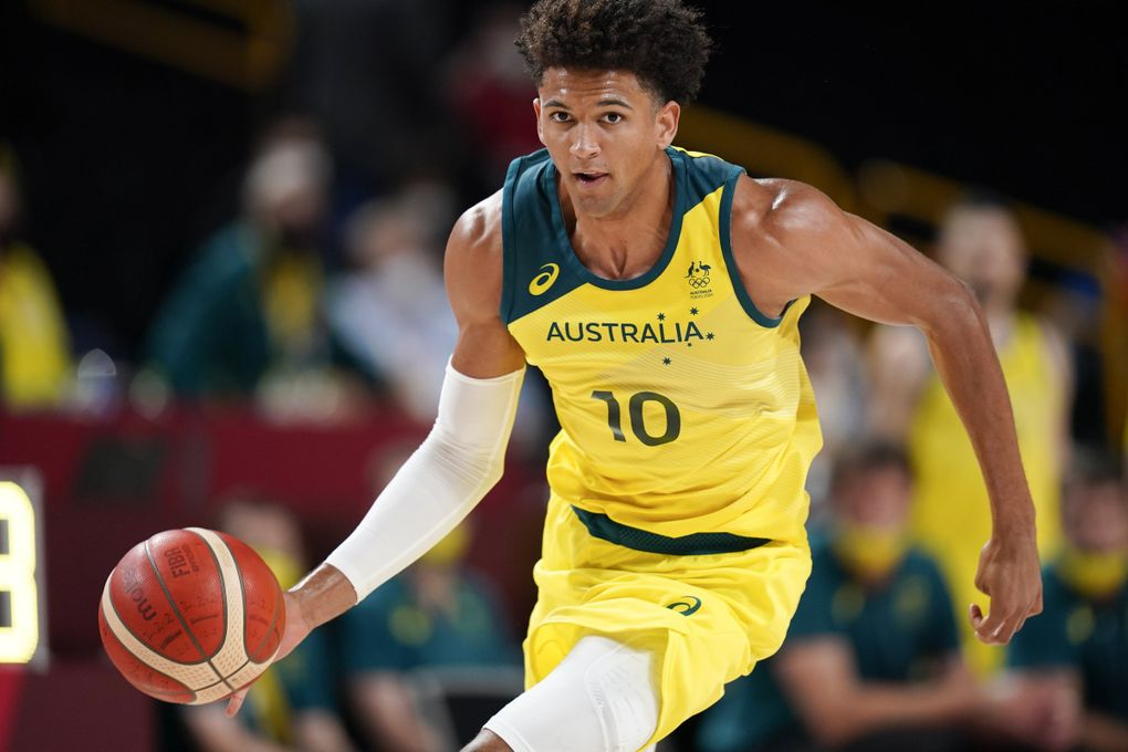 Australia's Matisse Thybulle drives up court during a men's basketball preliminary round game against Nigeria at the 2020 Summer Olympics, Sunday, July 25, 2021, in Saitama, Japan.(Charlie Neibergall / The Associated Press)