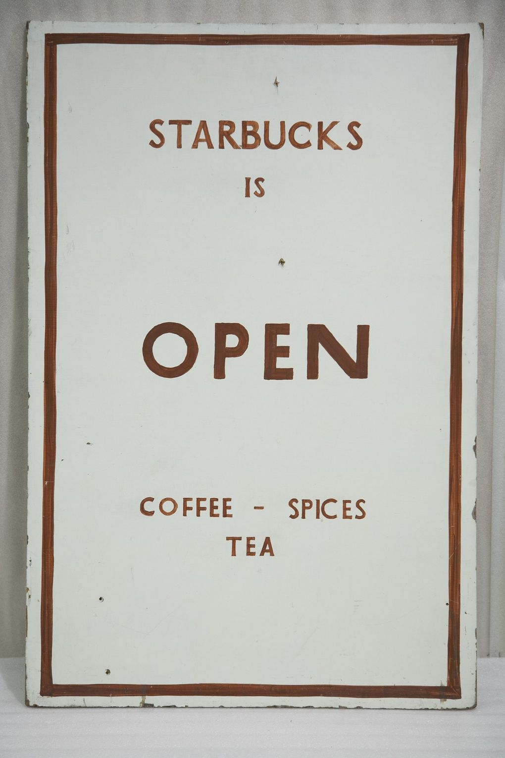 A hand-painted original sidewalk sign from the first Starbucks store in 1971 lives on at MOHAI. (Courtesy of MOHAI)
