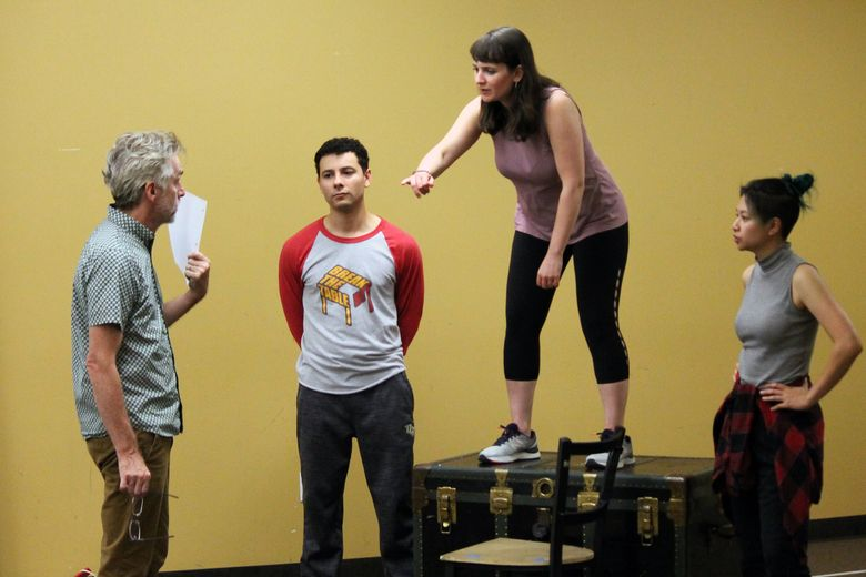 """Seattle Shakespeare Company artistic director George Mount (from left) directs Rico Lastrapes, Kelly Karcher and MJ Daly in a rehearsal for """"The Comedy of Errors.""""  (Courtesy of Seattle Shakespeare Company)"""
