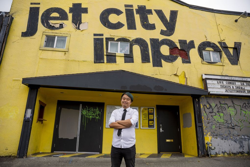 Michael Yichao, 33, stands in front of Jet City Improv on July 16 in the University District, where he used to work and put on shows. Yichao is a queer Asian American actor and writer in Seattle. His focus is on improv and comedy acting and he says he has turned down roles in the past because they were based off of stereotypes or lacked nuance. (Sylvia Jarrus / The Seattle Times)