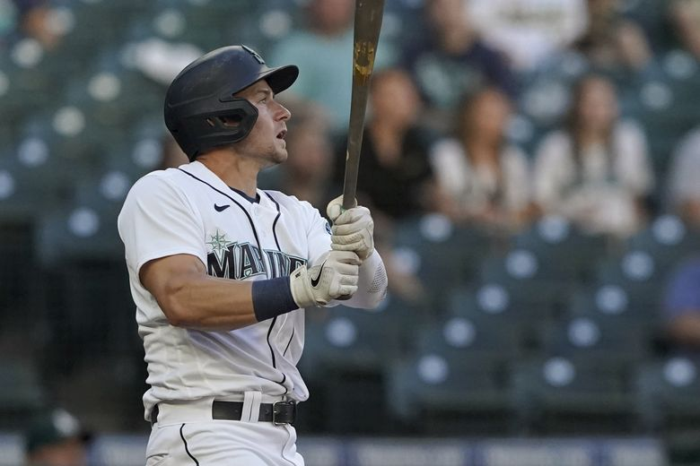 Seattle Mariners' Jarred Kelenic watches as his fly ball is caught for an out during the second inning of the team's baseball game against the Oakland Athletics, Tuesday, June 1, 2021, in Seattle. (Ted S. Warren / AP)