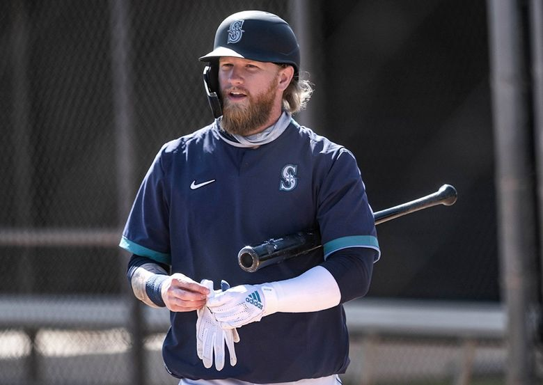 Jake Fraley waits his turn in the cage for batting practice.  The Seattle Mariners held spring training camp Saturday, February 27, 2021, at the Peoria Sports Complex in Peoria, AZ. (Dean Rutz / The Seattle Times)