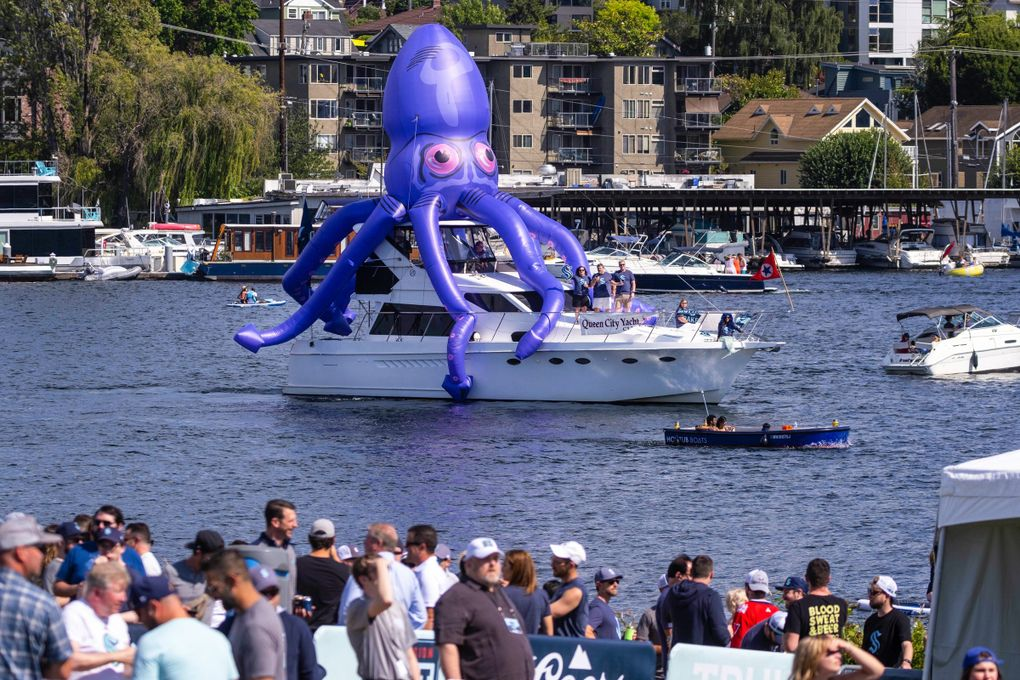 A Kraken tops a boat that is part of the flotilla of fans who turned out for the NHL Expansion Draft on Wednesday afternoon at Gas Works Park in Seattle. (Dean Rutz / The Seattle Times)