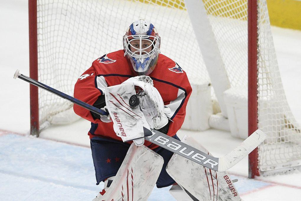 Washington Capitals goaltender Vitek Vanecek (41) stops the puck during the third period of an NHL hockey game against the Boston Bruins, Tuesday, May 11, 2021, in Washington. (Nick Wass / AP)