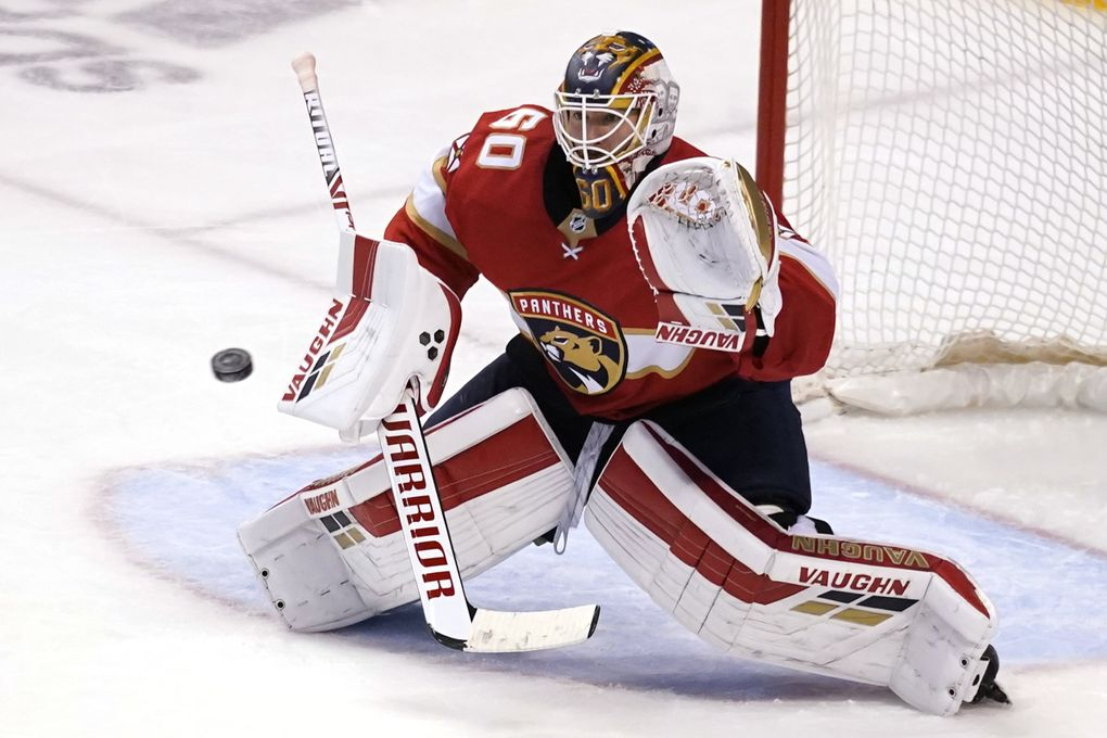 Florida Panthers goaltender Chris Driedger (60) defends the goal during the third period in Game 2 of an NHL hockey Stanley Cup first-round playoff series against the Tampa Bay Lightning, Tuesday, May 18, 2021, in Sunrise, Fla. (Lynne Sladky / AP)