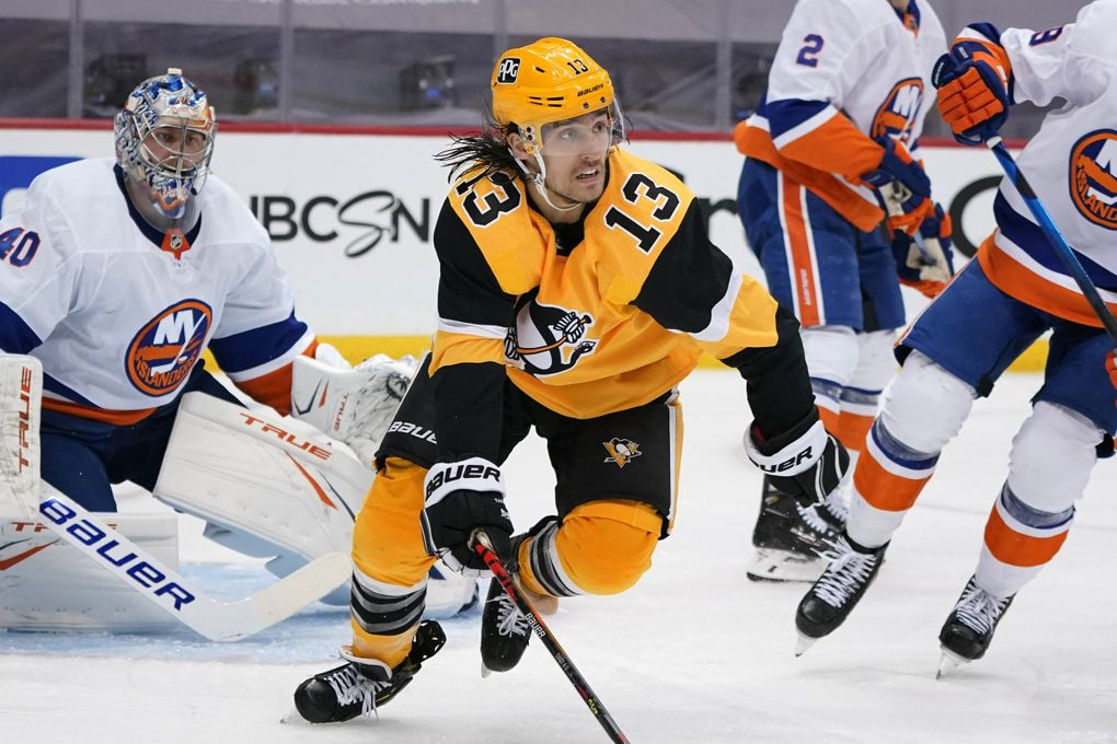 Pittsburgh Penguins' Brandon Tanev (13) plays in Game 2 of an NHL hockey Stanley Cup first-round playoff series against the New York Islanders in Pittsburgh, Tuesday, May 18, 2021. (Gene J. Puskar / AP)
