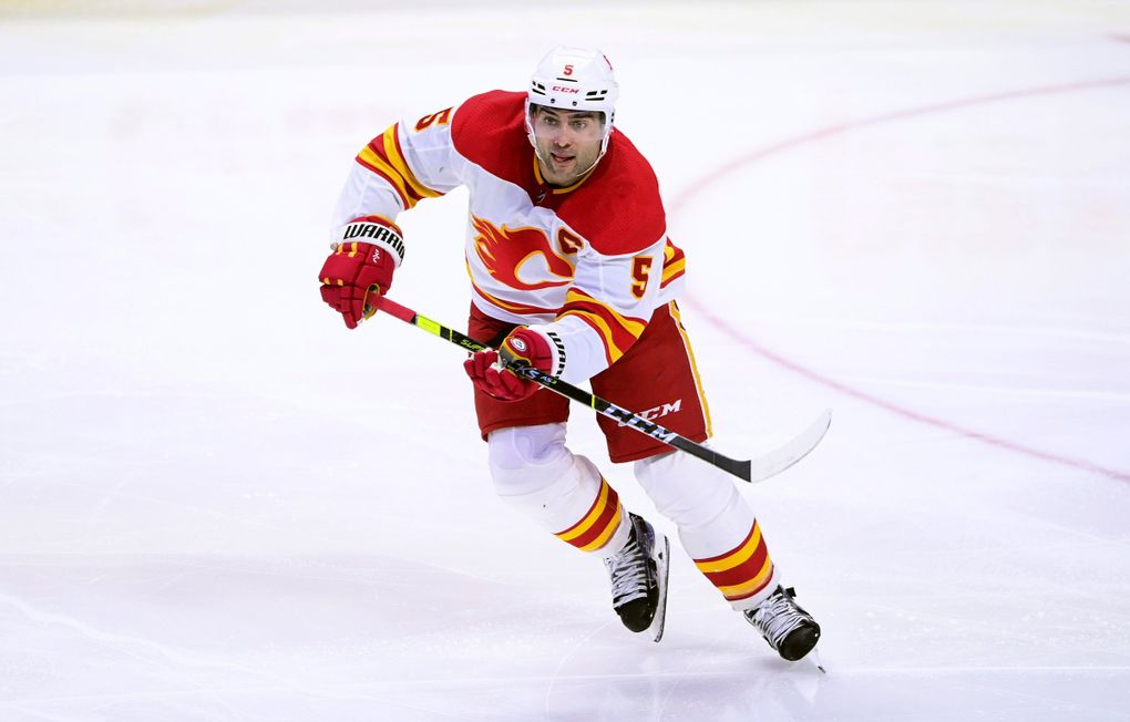 In this March 22, 2021 file photo, Calgary Flames captain Mark Giordano skates up the ice during the third period of an NHL hockey game against the Ottawa Senators in Ottawa, Ontario. (Sean Kilpatrick / AP)