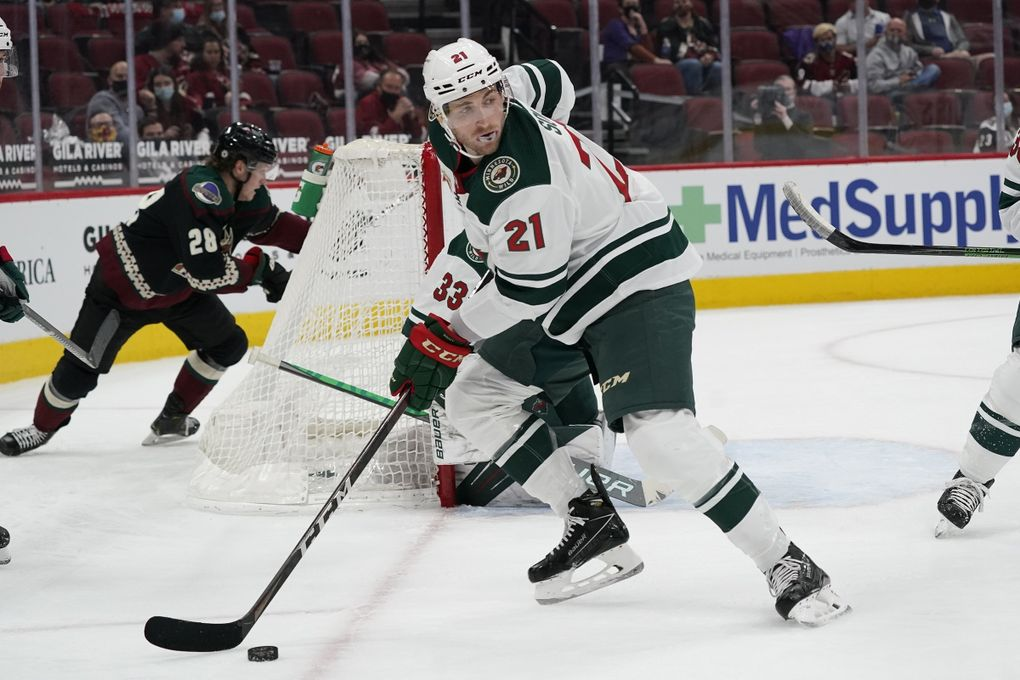Minnesota Wild defenseman Carson Soucy skates with the puck against the Arizona Coyotes during the first period of a game Wednesday, April 21, 2021, in Glendale, Ariz. (Ross D. Franklin / AP)