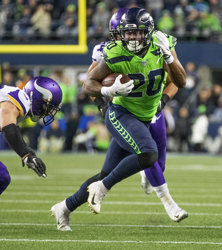 Seattle Seahawks running back Rashaad Penny (20) makes a late first half run setting up a field goal as the Minnesota Vikings play the Seattle Seahawks at CenturyLink Field in Seattle on December 2, 2019. (Mike Siegel / The Seattle Times)