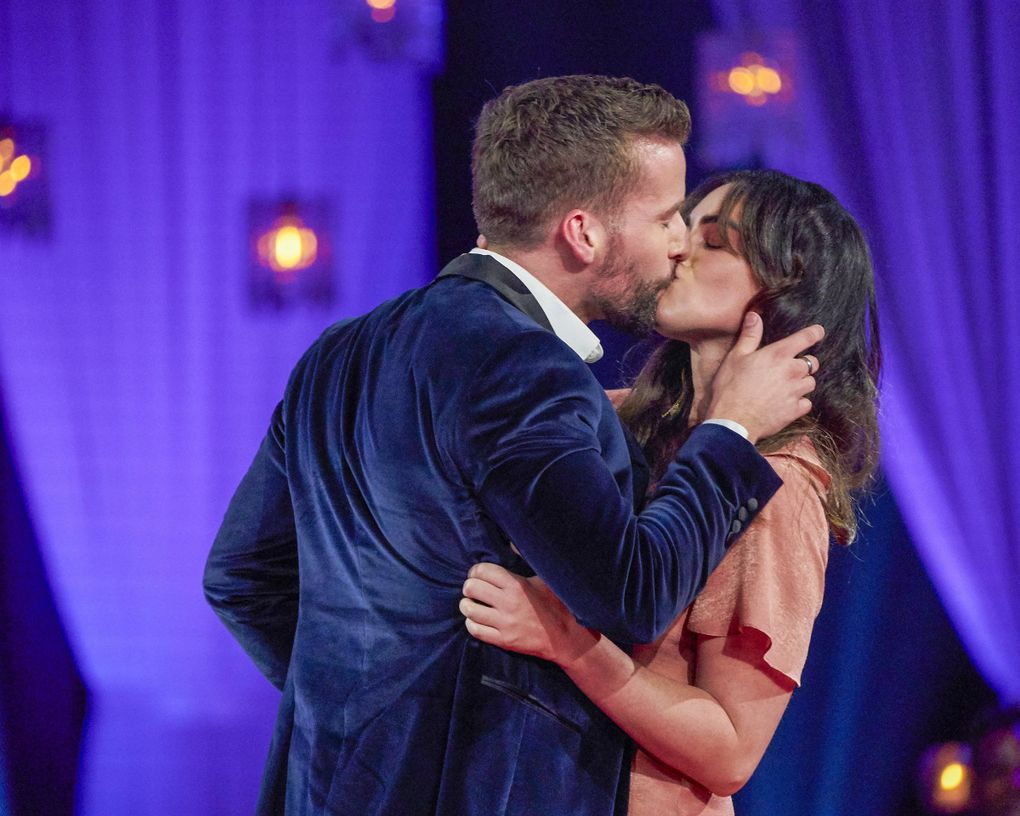 """A woman from the audience walked up to Connor Brennan and smooched him on Monday's """"The Bachelorette: The Men Tell All."""" (Craig Sjodin / ABC)"""