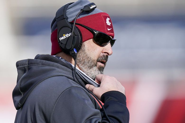 Washington State coach Nick Rolovich looks on during the first half of an NCAA college football game against Utah, Saturday, Dec. 19, 2020, in Salt Lake City.  (Rick Bowmer / AP)