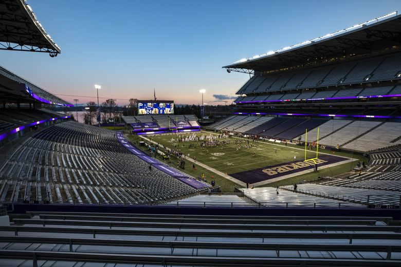 The winter sunset glows pink and blue just before kickoff for the University of Washington Huskies and the Utah Utes at Husky Stadium in Seattle Saturday November 28, 2020. (Bettina Hansen / The Seattle Times)