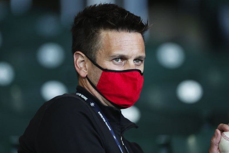 Mariners General Manager Jerry Dipoto watches M's relief pitcher Taylor Williams get the save in the ninth inning against the Rockies, Sunday, Aug. 9, 2020, at T-Mobile Park in Seattle. (Ken Lambert / The Seattle Times)