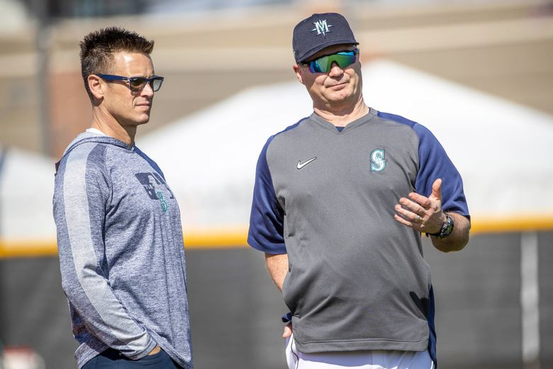 Mariners General Manager Jerry Dipoto, left, talks with Manager Scott Servais during 2020 Spring Training in Peoria, AZ.  (Dean Rutz / The Seattle Times)
