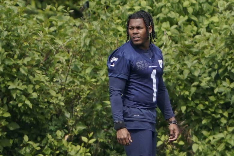 Seahawks wide receiver D'Wayne Eskridge watches drills during practice Tuesday, June 8, 2021, in Renton.  (Ted S. Warren / AP)