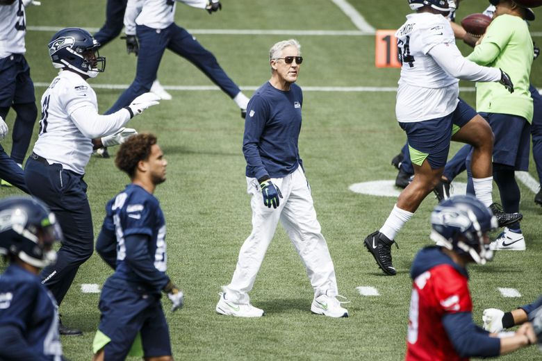 Seahawk's head coach Pete Carroll watches players warm up during OTA's on Tuesday at Virginia Mason Athletic Center.    Tuesday, June 8, 2021 (Amanda Snyder / The Seattle Times)