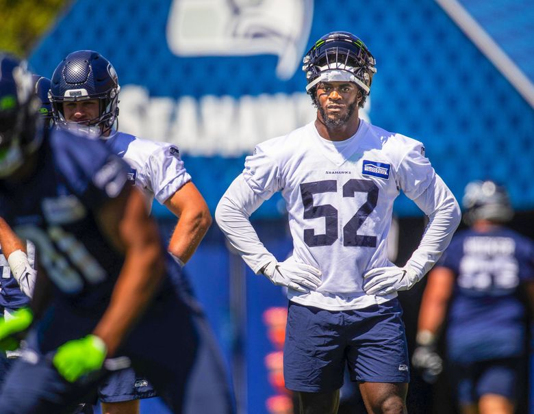 Linebacker Darrell Taylor (52) at the Seattle Seahawks training camp on Thursday in Renton. (Dean Rutz / The Seattle Times)