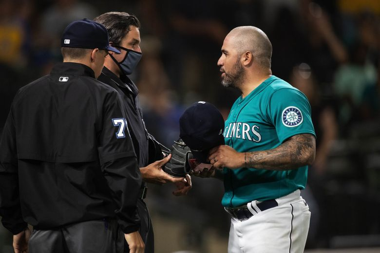Hector Santiago is checked by the umpires for foreign substances as he comes off the mound during a game on July 2, 2021. (Dean Rutz / The Seattle Times)
