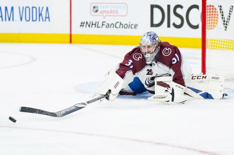 Colorado Avalanche goaltender Philipp Grubauer knocks the puck away against the Vegas Golden Knights during Game 4 the Stanley Cup second-round playoff series, June 6, 2021, in Las Vegas. (John Locher / AP)