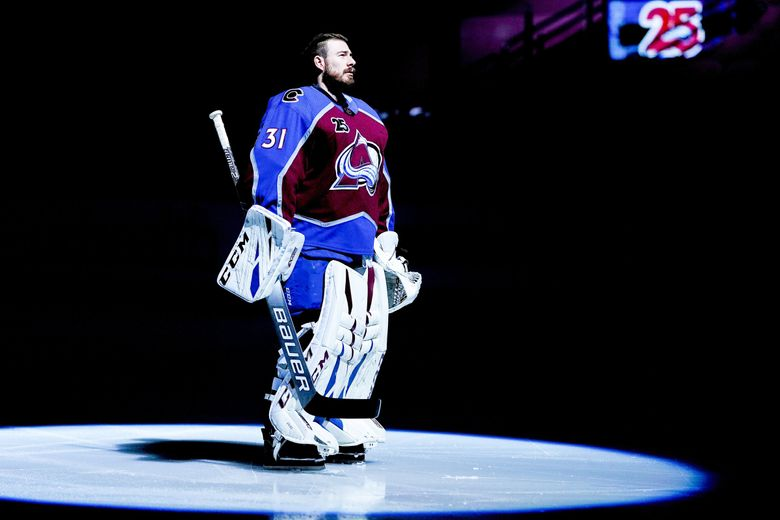 Colorado Avalanche goaltender Philipp Grubauer stands on the ice during player introductions before the team's NHL hockey game against the Los Angeles Kings on Wednesday, May 12, 2021, in Denver. (Jack Dempsey / AP)