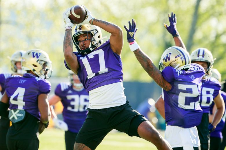 University of Washington wide receiver Taj Davis (17) rises for a catch at the east practice field on Monday, April 19, 2021.  (Erika Schultz / The Seattle Times)