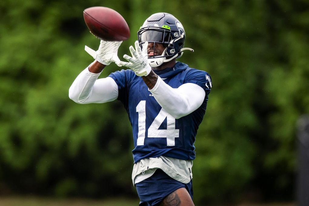 Seahawks wide receiver DK Metcalf makes a catch during Seahawks Training Camp at the Virginia Mason Athletic Center in Renton Saturday, July 31, 2021. (Bettina Hansen / The Seattle Times)