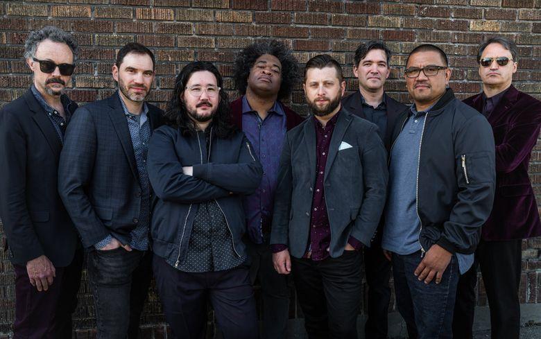 The True Loves: (from left) Bryant Moore, Gordon Brown, Greg Kramer, Jimmy James, Jason Cressey, Dave McGraw, Iván Galvez and Skerik.  (Nate Gowdy)