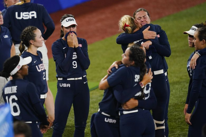 Members of team United States react after a softball game against Japan at the 2020 Summer Olympics, Tuesday, July 27, 2021, in Yokohama, Japan. Japan won 2-0. (Matt Slocum / The Associated Press)