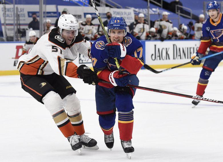 St. Louis Blues' Jaden Schwartz (17) skates against Anaheim Ducks' Haydn Fleury (51) during overtime of an NHL hockey game on Wednesday, May 5, 2021, in St. Louis.  (Joe Puetz / AP)