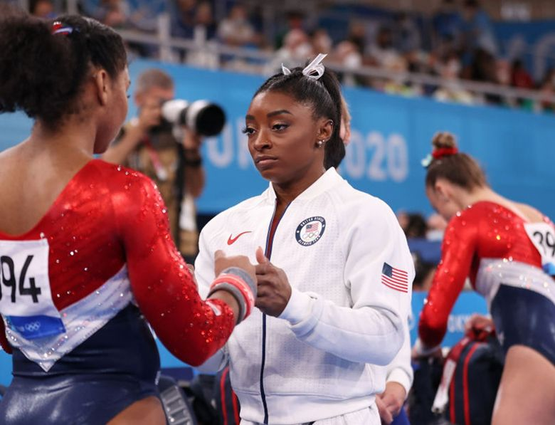 Simone Biles talks with Jordan Chiles of Team United States during the Women's Team Final on day four of the Tokyo 2020 Olympic Games at Ariake Gymnastics Centre on July 27, 2021 in Tokyo, Japan. (Laurence Griffiths / TNS)