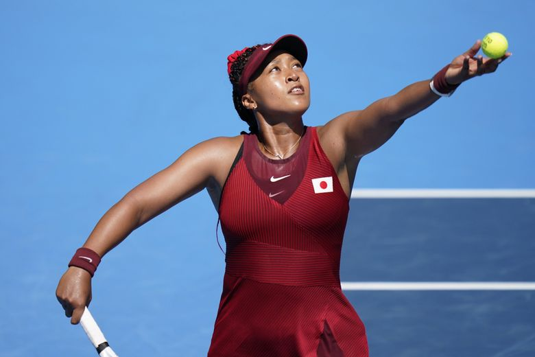 Naomi Osaka, of Japan, plays against Saisai Zheng, of China, during the first round of the tennis competition at the 2020 Summer Olympics, Sunday, July 25, 2021, in Tokyo, Japan. (AP Photo/Seth Wenig) OLYSW152 OLYSW152 (Seth Wenig / The Associated Press)