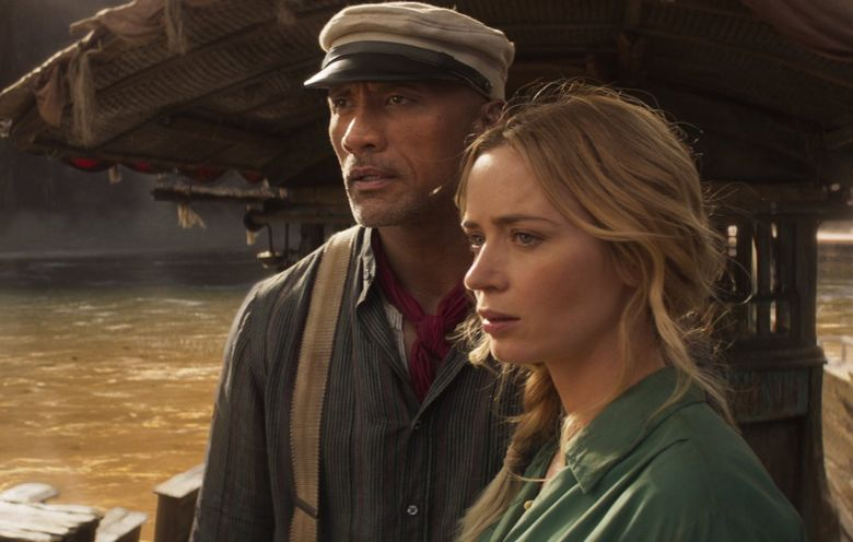 """""""Jungle Cruise"""" brings a riverboat captain (Dwayne Johnson) and a botanist (Emily Blunt) together for a bickersome ride. (Disney)"""