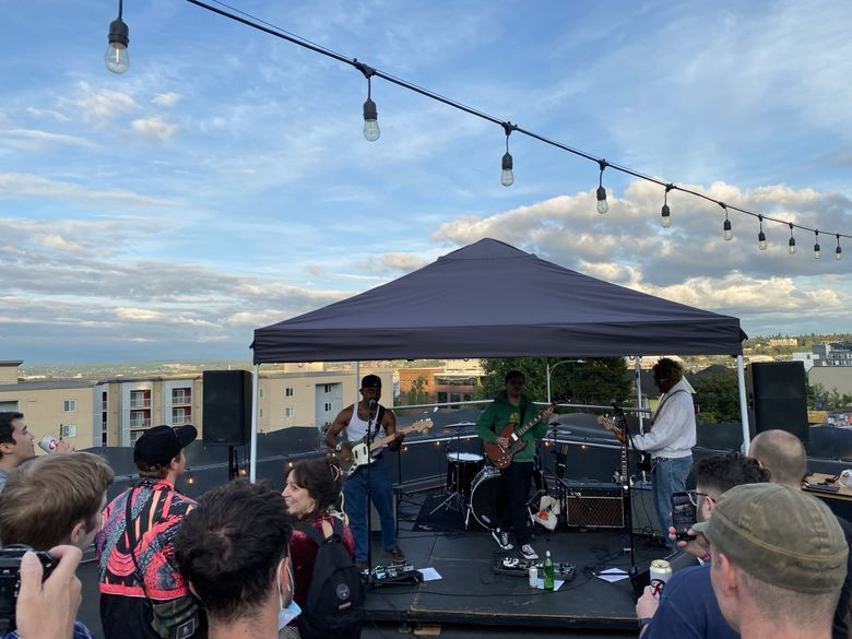 Buzzy Tacoma indie rockers Enumclaw played their first public show on Alma Mater's rooftop recently. (Michael Rietmulder / The Seattle Times)