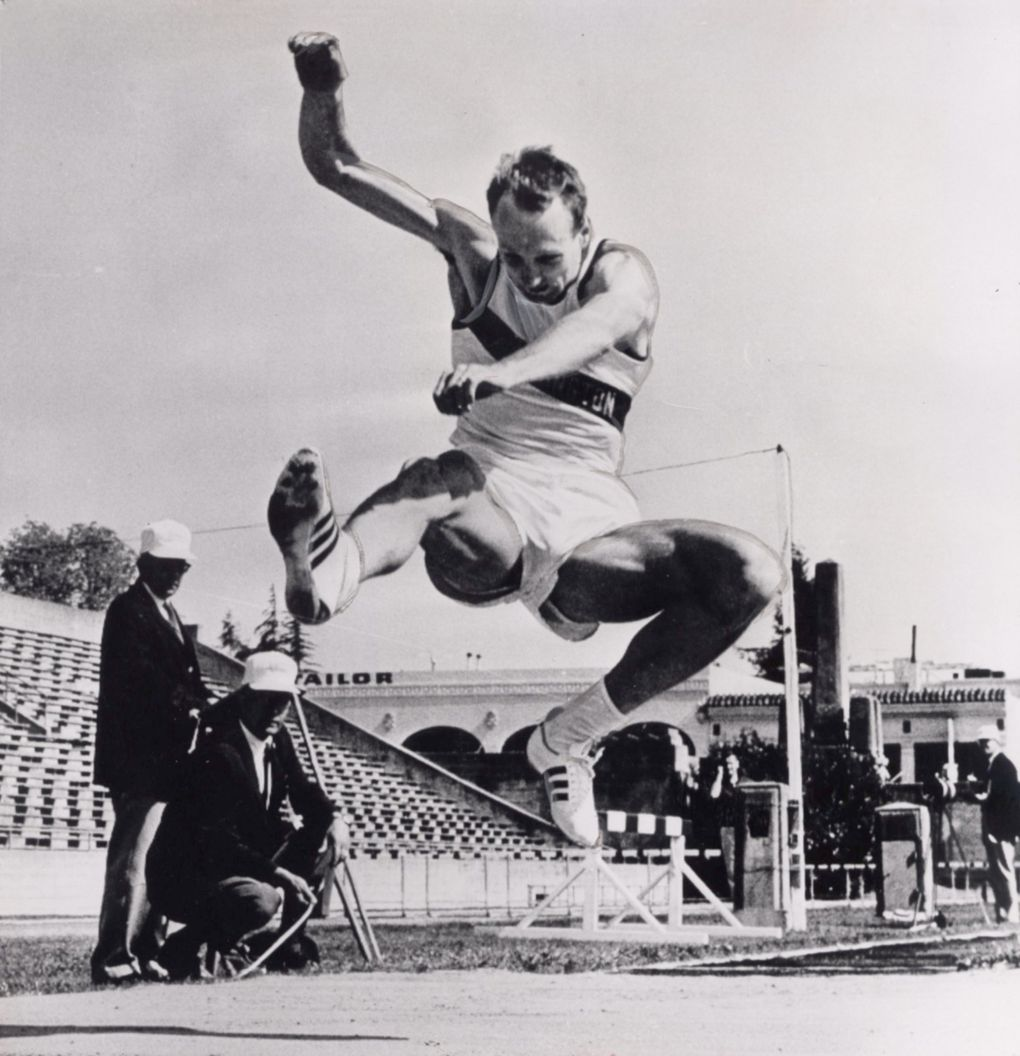 Phil Shinnick jumps during a meet for UW. (AP)