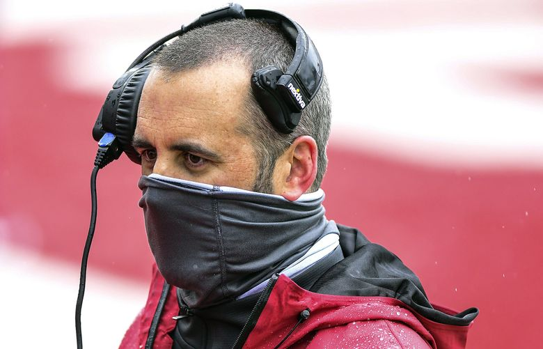Washington State coach Nick Rolovich walks into the locker room during halftime of Cougars' spring game April 24. (Pete Caster / The Associated Press)