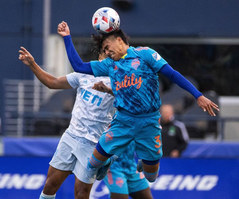 Seattle's Xavier Arreaga gets in front of Austin's Cecilio Dominguez for the header at midfield in the 2nd half.  Austin FC played the Seattle Sounders FC in MLS Soccer Sunday, May 30, 2021 at Lumen Field in Seattle, WA. 217261 (Dean Rutz / The Seattle Times)