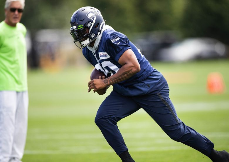 Rashaad Penny runs drills Wednesday.  The Seattle Seahawks opened camp to the general public Wednesday, July 28, 2021 at the VMAC in Renton, WA. 217729 (Dean Rutz / The Seattle Times)