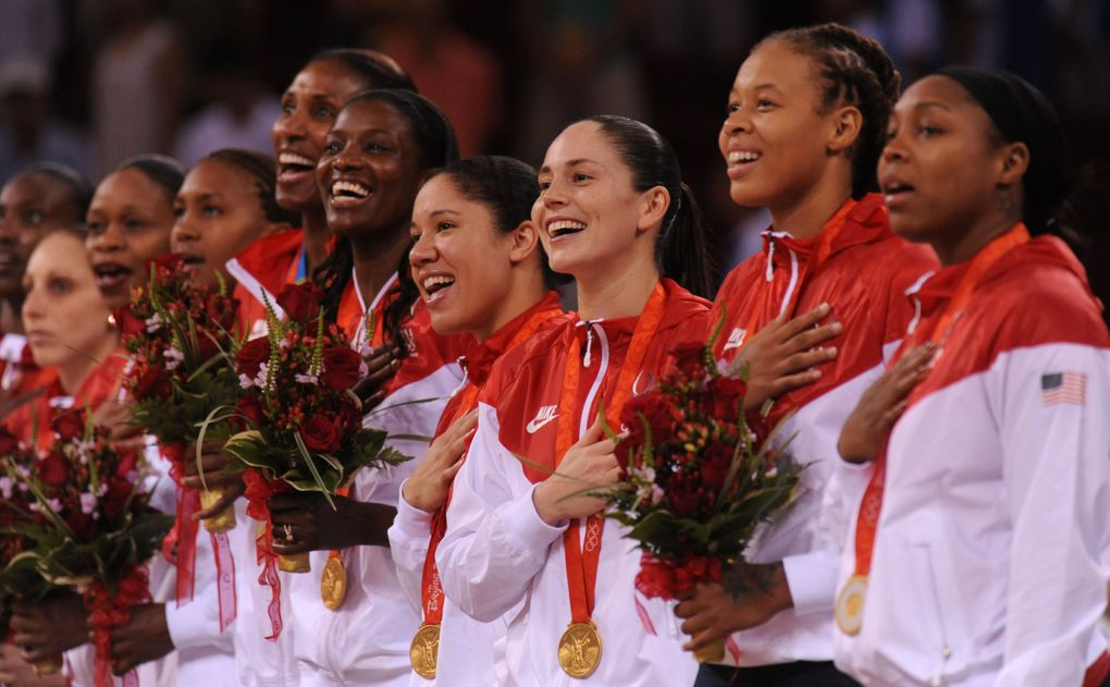 Members of the USA gold medal winning women's basketball team sing the Star Spangled Banner during the medal ceremonies after they routed Russia for the title. (ROD MAR / The Seattle Times)