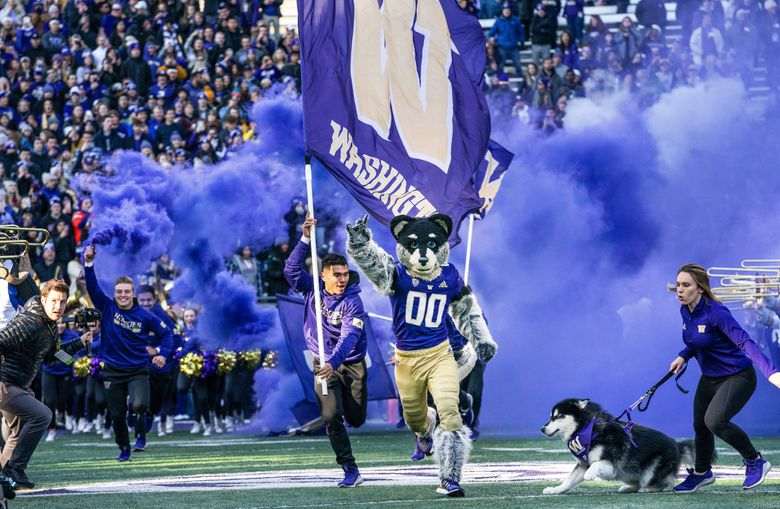 The Huskies come out against Washington State before the 2019 edition of the Apple Cup game at Husky Stadium in Seattle, WA Friday, November 29, 2019. (Dean Rutz / The Seattle Times)