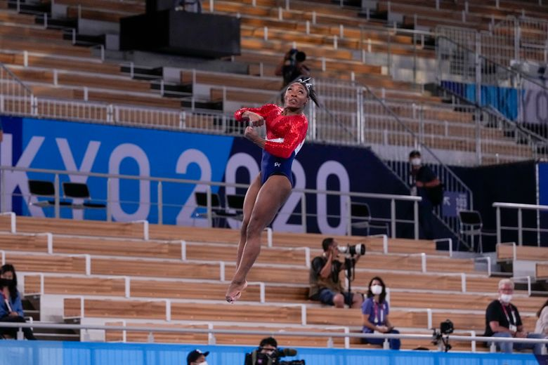 """Simone Biles performs on the vault during Tuesday's team final. """"I had no idea where I was in the air,"""" she said later. (Washington Post photo by Toni L. Sandys)"""