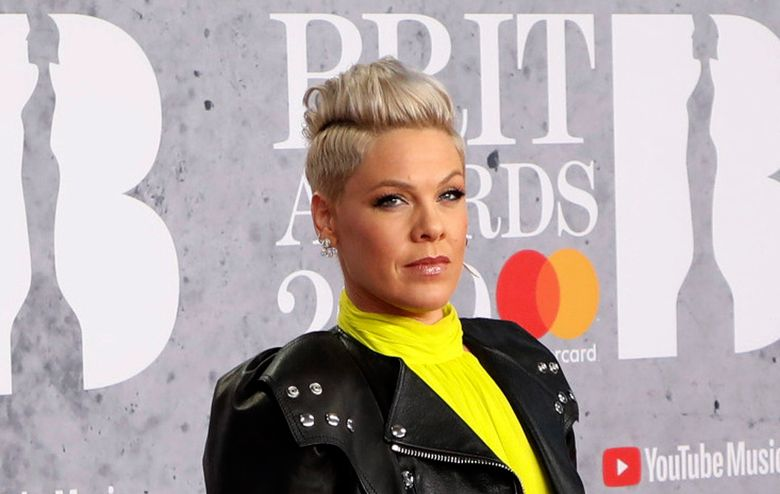 """FILE – In Wednesday, Feb. 20, 2019 file photo, singer Pink poses for photographers upon arrival at the Brit Awards in London.  U.S. pop singer Pink has offered to pay a fine given to the Norwegian female beach handball team for wearing shorts instead of the required bikini bottoms. Pink said she was """"very proud"""" of the team for protesting against the rule that prevented them from wearing shorts like their male counterparts. At the European Beach Handball Championships in Bulgaria last week, Norway's female team was fined 1,500 euros ($1,770) for what the European federation called improper clothing and """"a breach of clothing regulations."""" (Photo by Vianney Le Caer/Invision/AP, File)"""
