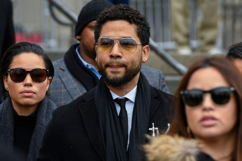 """FILE – In this Feb. 24, 2020 file photo, former """"Empire"""" actor Jussie Smollett leaves the Leighton Criminal Courthouse in Chicago. A judge on Friday, July 30, 2021, announced that he would not kick one of Smollett's attorneys off the case, saying that although he believed the attorney talked to two men the actor allegedly hired to carry out a phony racist and homophobic attack, that such conversations should not disqualify him from the case. (AP Photo/Matt Marton, File)"""
