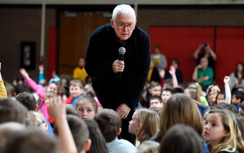 """FILE – In this Wednesday, March 4, 2020, file photo, children's book author and illustrator Marc Brown, an Erie, Pa., native, meets with Grandview Elementary School students in Millcreek Township, Pa. Brown is a three-time Emmy award winner and the creator of the """"Arthur"""" television series adapted from his books. """"Arthur"""" will soon come to an end. Kathy Waugh, an original developer of the show, said during a podcast released Wednesday, July 28, 2021, that PBS Kids plans to end the long-running children's series after 25 seasons. The final season will air in 2022. (Jack Hanrahan/Erie Times-News via AP, File)"""