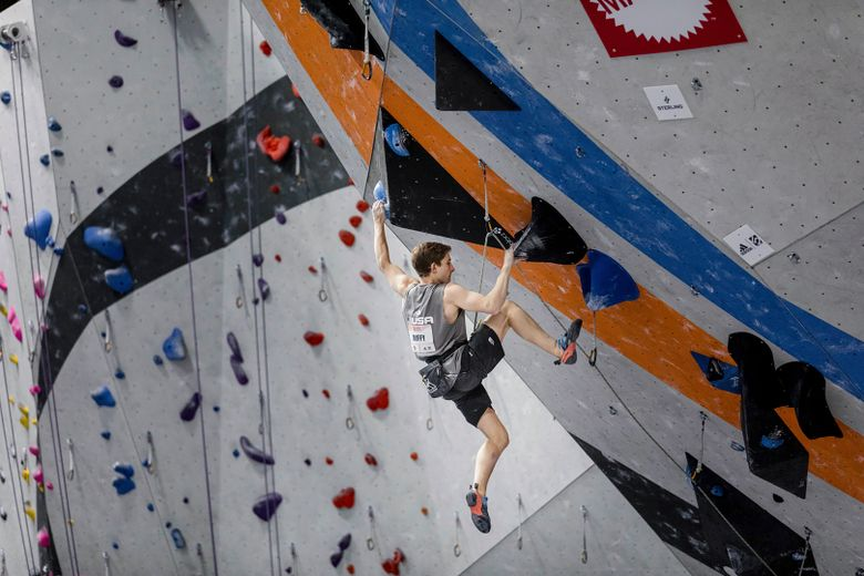 In a photo provided by USA Climbing, Colin Duffy competes in the Pan American Championships in Los Angeles in March 2020. Duffy had his eyes on the 2024 Paris Olympics. A natural climbing ability and mathematical mind pushed his timeframe forward, allowing him to become one of the youngest athletes at the Tokyo Games at 17. (Lucas W Webster/USA Climbing via AP)