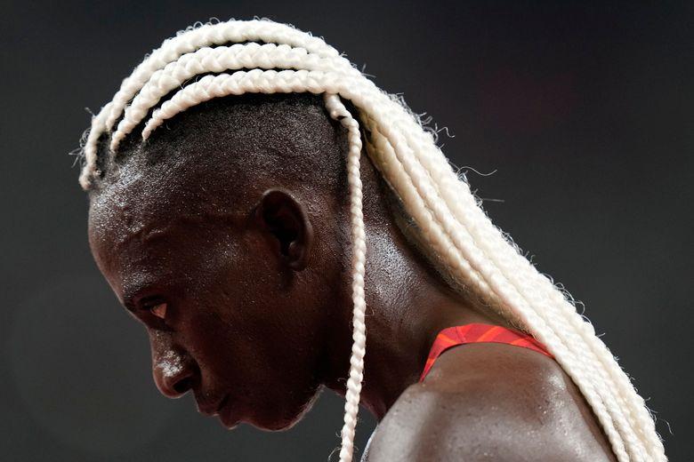 Francine Niyonsaba, of Burundi, finishes a heat in the women's 5,000-meter run at the 2020 Summer Olympics, Friday, July 30, 2021, in Tokyo. (AP Photo/Petr David Josek)