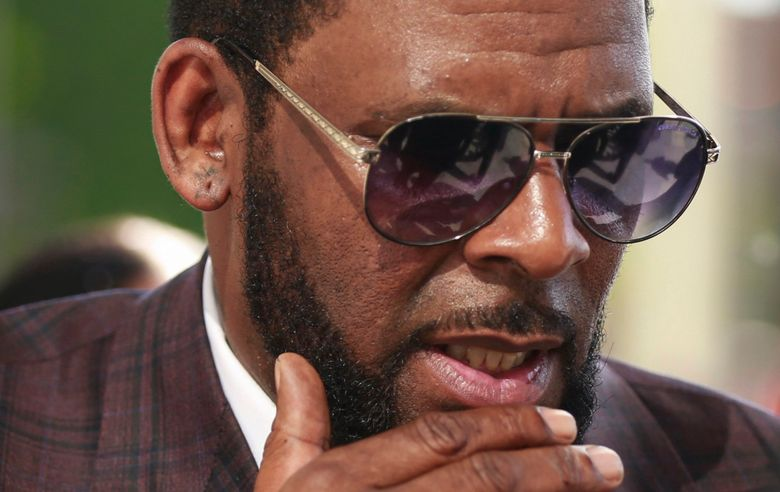 FILE – This photo from Wednesday June 26, 2019, shows R&B singer R. Kelly arriving at the Leighton Criminal Court in Chicago for arraignment on sex-related charges. Federal prosecutors in New York on Friday, July 23, 2021 asked a judge for permission to admit more evidence for which Kelly has not been charged, at his upcoming sex-trafficking trial in Brooklyn. (AP Photo/Amr Alfiky, File)